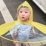 Hands-free umbrella kid living in 3017 meme costume