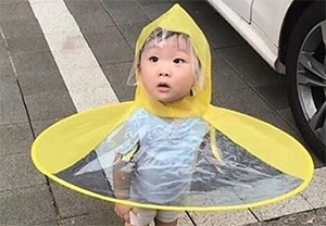 Hands-free umbrella kid living in 3017 meme costume